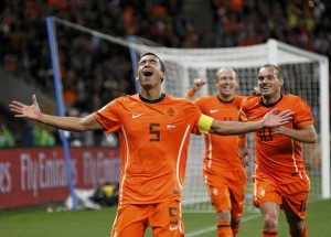 Netherlands' Van Bronckhorst celebrates after scoring a goal during their 2010 World Cup semi-final soccer match against Uruguay in Cape Town